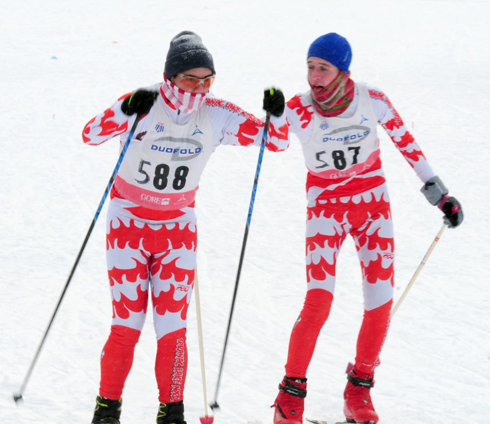 Saranac Lake's Griffin Smith, right, tags off to Brennan Nobles in a boys varsity cross-country ski relay race Saturday in Queensbury. (Enterprise photo — Peter Crowley)