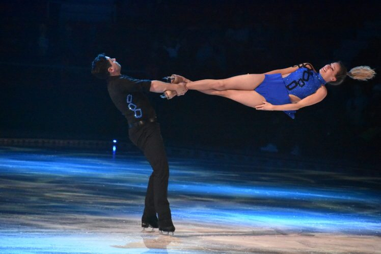 """Brent Bommentre swings Kim Navarro completely horizontal. The two time U.S. Figure Skating Championships bronze medal winners skated to Soft Cell's """"Tainted Love."""" (Enterprise photo — Griffin Kelly)"""