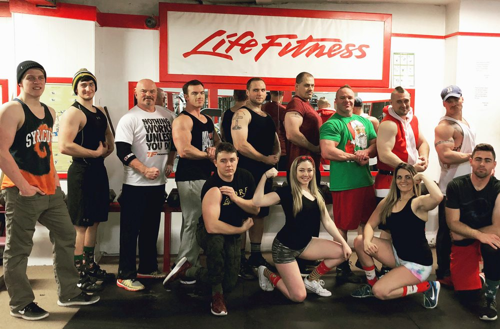 Members of Rock Hard Fitness in Saranac Lake pose for a photo on Christmas Day. Members of the gym — on Broadway — get together to lift on the holiday, and owner Trevor Rock said the tradition has grown each of the last three years. From left, standing, are Jacob Alberga, Donny Nadon, Doc Ward, Moses Connors, Liam Ward, Will O'Reilly, Keith Brown, Trevor Rock and Dustin Conger. Kneeling are Dylan Kilner, Lizzie Romano, Ashley Pittman and Torin Smith. (Photo provided)