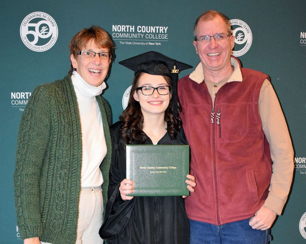 Jaclyn Latourelle of Saranac Lake, flanked by her parents JoAnn and Alan Latourelle, earned a Health Science degree from North Country Community College in December. (Photo provided — Chris Knight, NCCC)