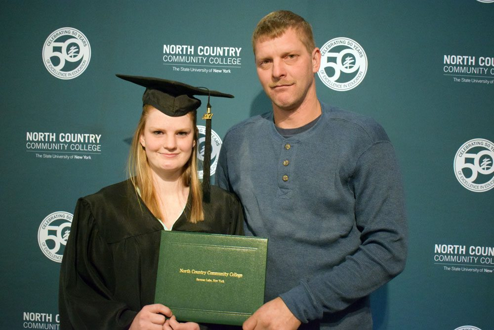 Amanda Warner of Malone stands with her father Cory Warner after receiving her AA Liberal Arts and Sciences: Humanities and Social Science degree in December from North Country Community College. (Photo provided — Chris Knight, NCCC)