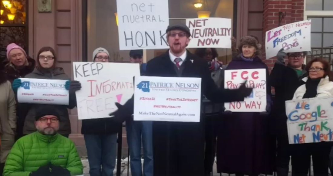 Democratic congressional candidate Patrick Nelson, center, and others protest outside U.S. Rep. Elise Stefanik's Glens Falls district office on Dec. 15, the day after the Federal Communications Commission decided to dismantle net neutrality rules. (Photo provided by Patrick Nelson)