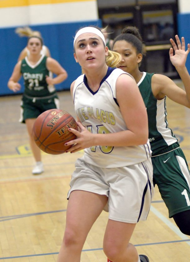 Graci Daby drives to the hoop for a second-half layup in front of Chazy's Mackenzie Chapman during the second half of Thursday's game.  (Enterprise photo — Lou Reuter)