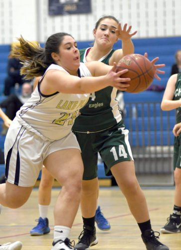 Kaleigh McKillip of Lake Placid grabs a rebound in front of Chazy's Olivia Rotella during Thursday's game on the Blue Bombers' floor. (Enterprise photo — Lou Reuter)