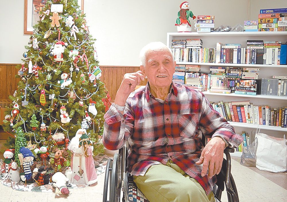 John Amoriell, the oldest man in Tupper Lake, sits in a room of the Adirondack Health's Mercy Living Center that he used to clean when it was an operating room in a hospital. He now lives in the nursing home, and after 106 years of traveling around the East Coast, he is happy to spend his centennial years in his hometown. (Enterprise photo — Aaron Cerbone)