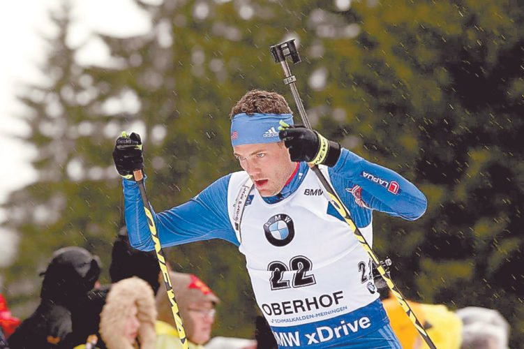 Biathlete Tim Burke, center, races in the rain in the men's 10-kilometer sprint Friday at the BMW IBU World Cup 4 in Oberhof, Germany. (Photo provided — Nordic Focus)