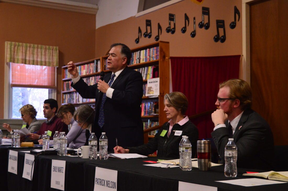 Democrat Ronald Kim addresses a crowd of around 200 voters at a forum held by Citizens Acting Together for District 21 to showcase the ideas and opinions of the candidates running for Congress. Other Democratic candidates, from left to right, include Tanya Boone, Don Boyajian, Tedra Cobb, Sara Idleman, Emily Martz and Patrick Nelson. Katie Wilson sits out of frame to the right. (Enterprise photo — Aaron Cerbone)