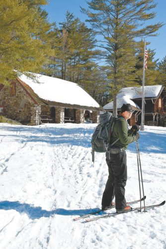 Neilson Snye, of Tupper Lake, takes in the view during a ski out to the historic great camp Santanoni last February. The DEC will open several of the buildings to the public during three weekends this winter. (Enterprise photo — Justin A. Levine)