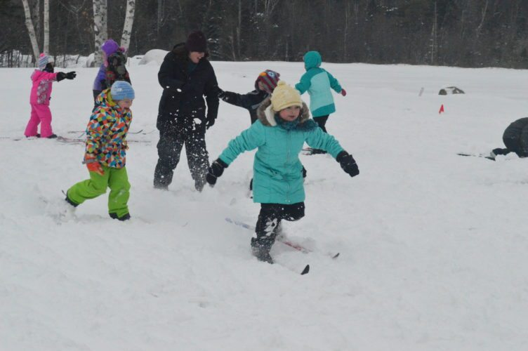 Kids learning to ski at cross-country trails at Tupper Lake's golf course play Moose Juice, a game ski instructor Ken Kalil uses to improve their coordination while they try to chase down and tag each other out. (Enterprise photo — Aaron Cerbone)