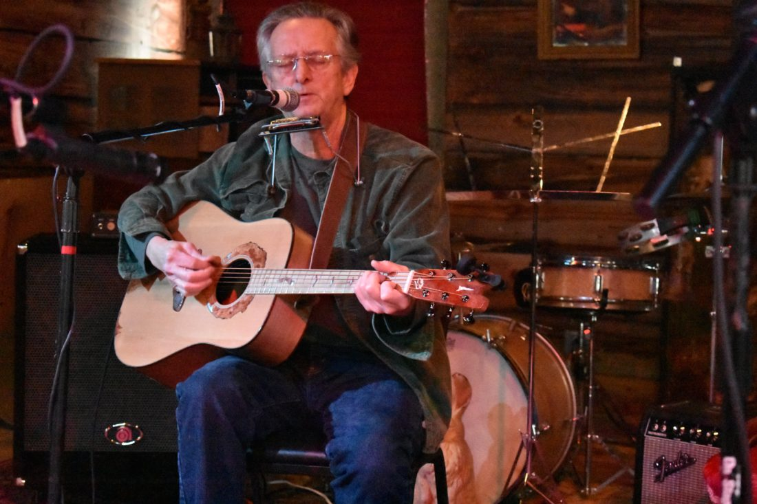 Eric Bright of BassRock Guitars in Schroon Lake plays one of his homemade  instruments at January Jams. (Enterprise photo —Griffin Kelly)