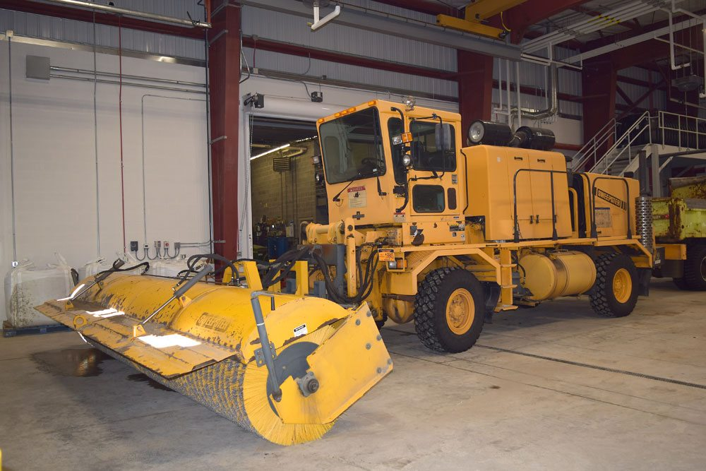 The breakdown of this broom, a critical piece of equipment for the Adirondack Regional Airport, during Dec. 23 snowstorm meant crews could not keep the runway clear and dry.  (Enterprise photo — Glynis Hart)