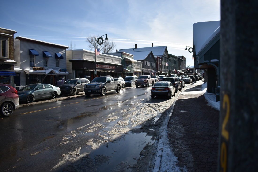 Main Street in Lake Placid will undergo some sewer line upgrades this spring, including replacing an outdated pipe near Saranac Avenue, eliminating a lift station and strengthening sewer lines underneath many businesses.  (Enterprise photo — Griffin Kelly)