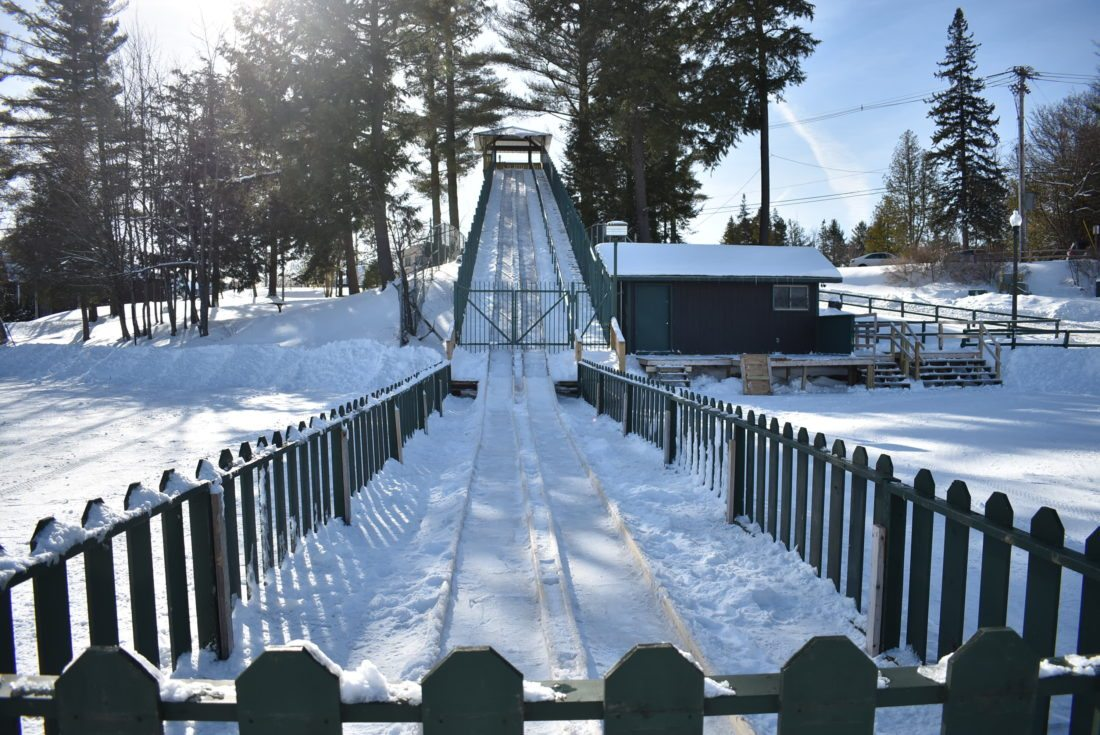 The Lake Placid Toboggan Chute on Mirror Lake is expected to open this weekend despite today's mild and rainy weather. (Enterprise photo — Griffin Kelly)