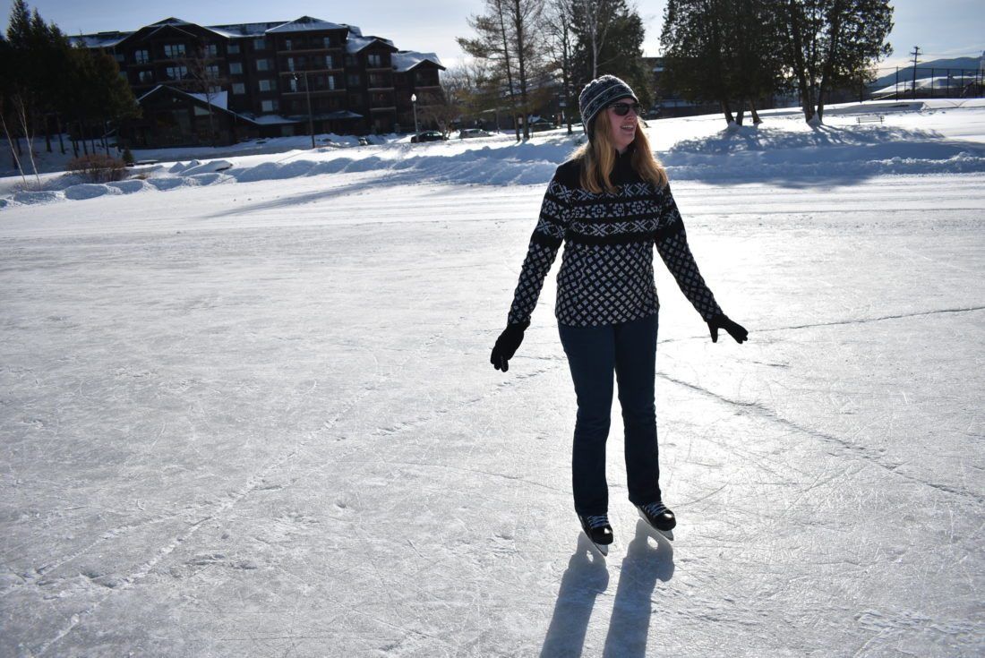 Hilary Hamer, left, of Andover, Massachusetts skates on the ice rink on Mirror Lake in Lake Placid.  (Enterprise photo — Griffin Kelly)