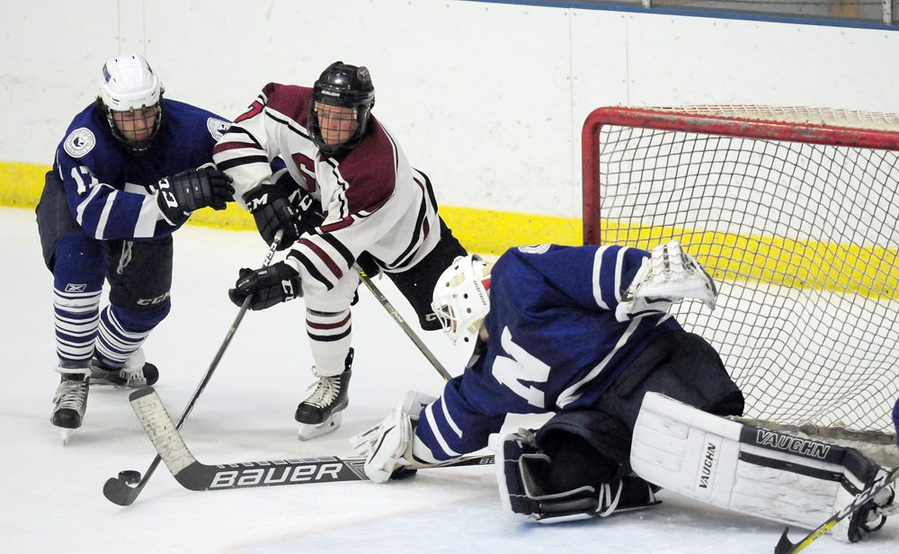 Northwood junior team goalie Mathew Petizian swipes the puck away from danger during a game against Shattuck-St. Mary's during last year's tournament action at the Olympic Center. The host Huskies will have three teams in action this weekend at the 39th annual Northwood Invitational Hockey Tournament at the Olympic Center in Lake Placid. (Enterprise file photo — Lou Reuter)