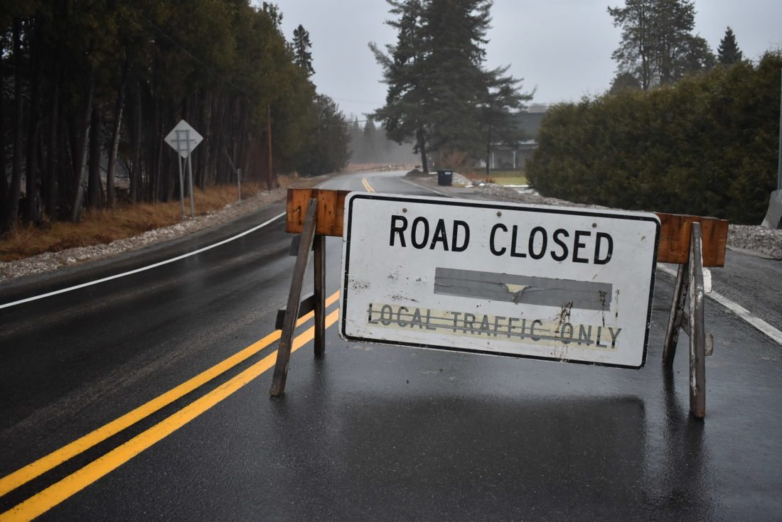 River Road in Lake Placid was closed Friday because of heaving rains and melting snow. (Enterprise photo — Griffin Kelly)