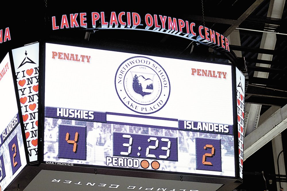 The 1980 Rink scoreboard displays Northwood's 4-2 lead late in Friday's game. The Huskies tacked on one more goal, and empty-netter, in the win. (Enterprise photo — Lou Reuter)