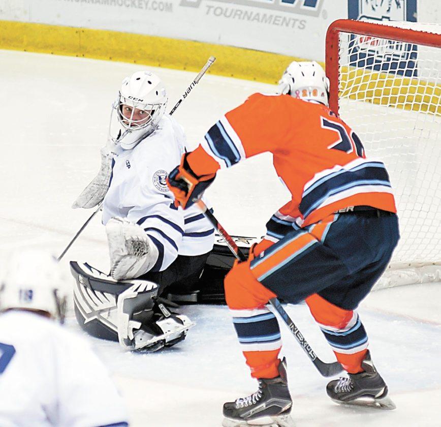 Northwood goaltender Wyatt Friedlander keeps a close eye on an Islanders opponent skating in front of the next during Friday's game.   (Enterprise photo — Lou Reuter)
