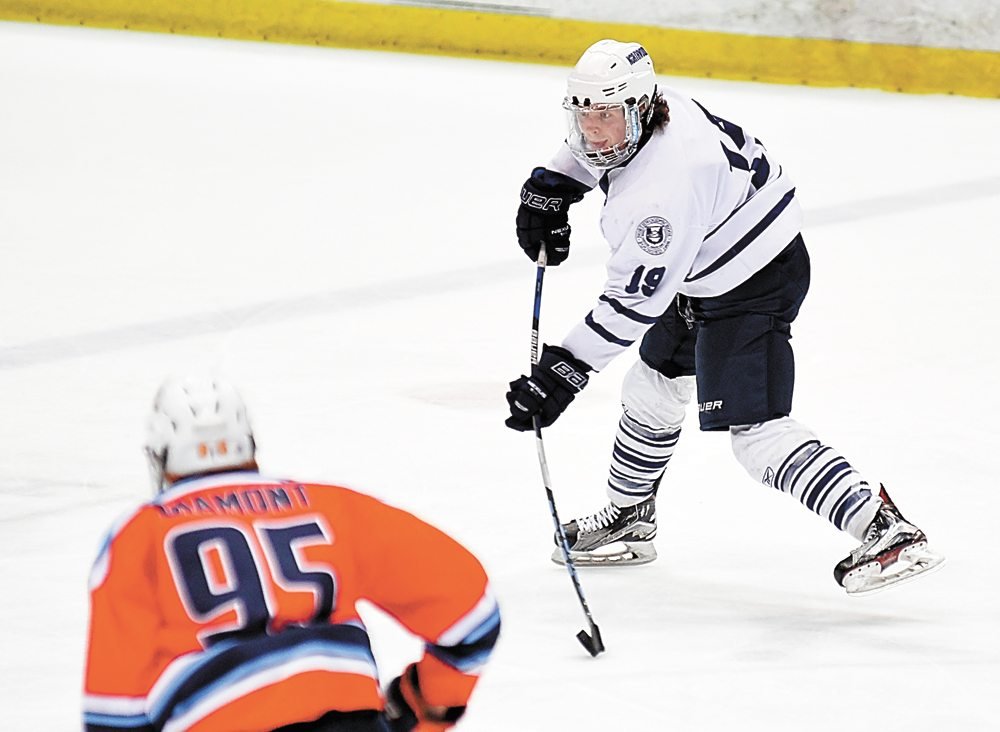 Northwood prep's Jack Pensa fires the puck into the Islanders' end of the rink during the first half of Friday's game. (Enterprise photo — Lou Reuter)