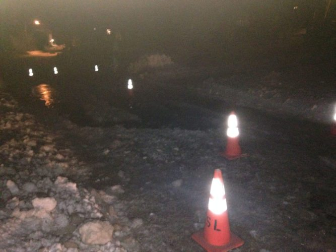 Traffic cones block off a section of Margaret Street in Saranac Lake Sunday evening. The village Department of Public Works closed parts of Margaret, Park Avenue and Baker Street to cars Sunday after runoff from Mount Pisgah flowed through the streets and froze, causing a traffic hazard, according to DPW Superintendent Jeff Dora. The roads will be reopened when the temperature warms up enough so salt is effective, which may be today, Dora said. (Enterprise photo — Peter Crowley)
