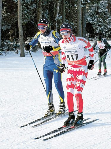 Lake Placid's Scott Schulz, left, and Saranac Lake's Lauchlan Cheney-Seymour take an early lead during Monday's Section VII Invitational cross-country ski meet at Mount Van  Hoevenberg outside Lake Placid. The pair went on to finish one-two out of a field of 40 racers from at least 10 schools around the state. (Enterprise photo — Justin A. Levine)