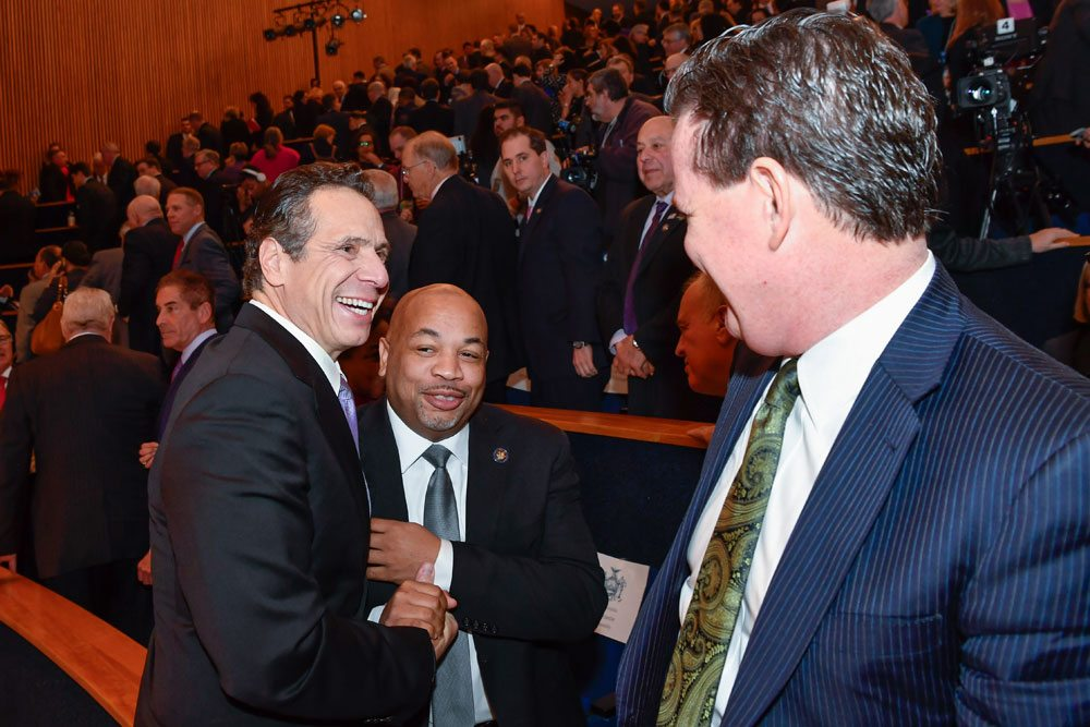 Gov. Andrew Cuomo, left, greets Assembly Speak Carl Heastie as he delivers his 2018-19 Executive Budget Address at the New York State Museum's Clark Auditorium Tuesday. (Photo provided — Darren McGee, governor's office)