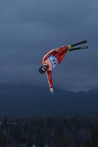 A Swiss aerials competitor twists in the early evening light during training Tuesday for this weekend's freestyle World Cup competition in Lake Placid. The Olympic Ski Jump Complex, where the aerials event takes place on Friday and Saturday, is one of the venues operated by the Olympic Regional Development Authority. It could see upgrades as part of the New York state budget plan Gov. Andrew Cuomo unveiled Tuesday. (Enterprise photo — Lou Reuter)
