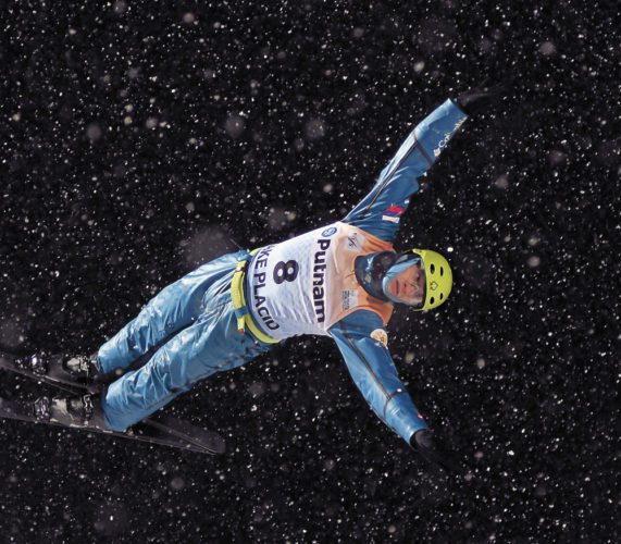 Russia's Ilia Burova flies through the night Tuesday as training started for the aerials World Cup event taking place Friday and Saturday in Lake Placid. (Enterprise photo — Lou Reuter)