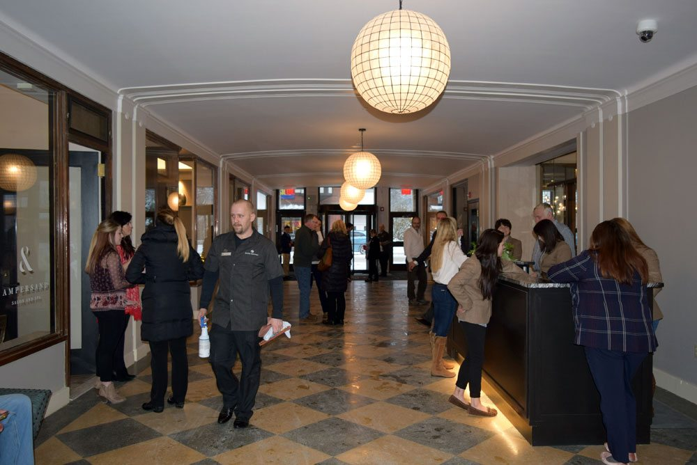 Saranac Lakers gather in the Hotel Saranac's reopened arcade as soon as the doors open at 4 p.m. today.  (Enterprise photo — Glynis Hart)