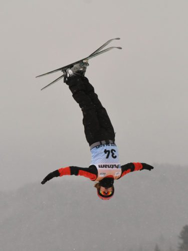 Akmarzhan Kalmurzayeva of Kazakhstan takes flight during a training jump Wednesday in preparation for the World Cup aerials competition being held today and Saturday in Lake Placid. (Enterprise photo — Lou Reuter)