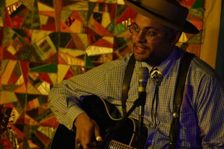 Dom Flemons,  a Grammy Award-winning musician, singer-songwriter and slam poet, performs Thursday night at BluSeed Studios in Saranac Lake. (Enterprise photo — Griffin Kelly)