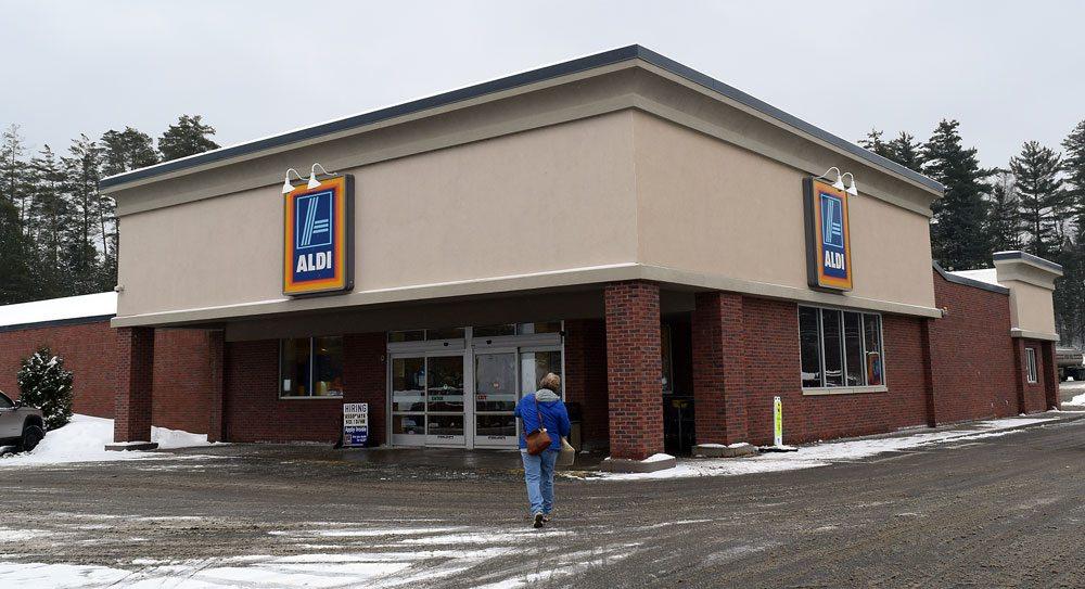 A woman walks into the Aldi supermarket in Saranac Lake in mid January. (Enterprise photo — Glynis Hart)