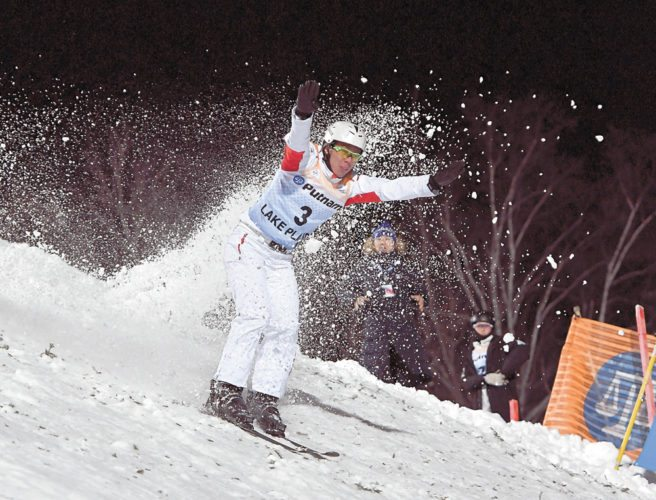 China's Zongyang Jia nails his landing on the jump that saw him clinch the gold medal in the men's aerials World Cup on Friday.  (Enterprise photo — Lou Reuter)