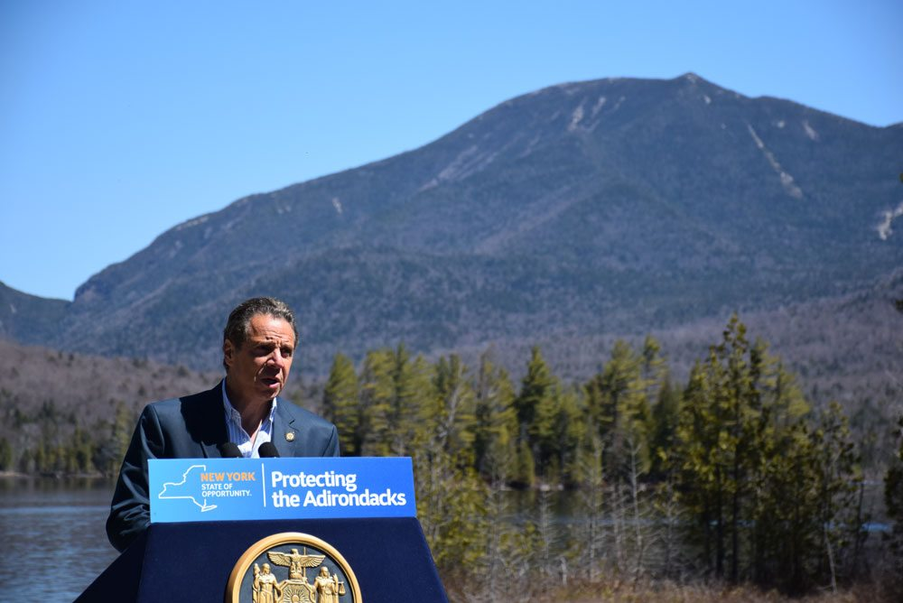 Gov. Andrew Cuomo speaks at the Elk Lake Lodge in North Hudson last May, when he announced the state's purchase of the 20,000-acre Boreas Ponds Tract from The Nature Conservancy. The state APA is expected to vote on a classification for the parcel next week, which is one of the most hotly debated land decisions in Adirondack history. (Enterprise photo — Justin A. Levine)