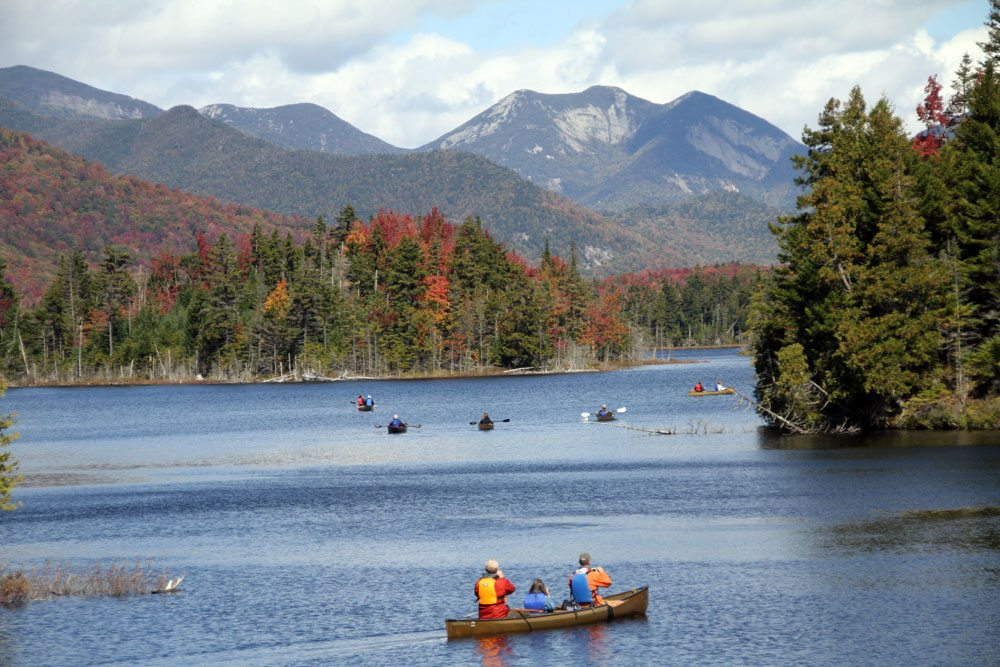 New York state government officials and news reporters paddle on Boreas Ponds in September 2012. In the background is the Great Range — from left, Basin, Saddleback, Gothics and Pyramid — in the High Peaks Wilderness. (Enterprise photo — Mike Lynch)