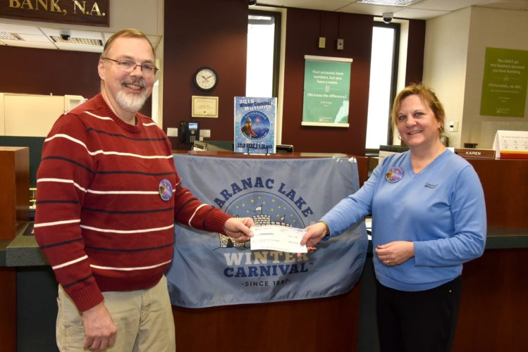 Community Bank N.A. recently presented Saranac Lake Winter Carnival with a $500 donation to support the organization's 2018 event, to be held Feb. 2-11. Specifically, the donation will sponsor the Adult Cross-Country Ski Races. Pictured, from left, are Stephen Dehond, sponsorship committee, and Community Bank N.A. Vice President District Manager Brenda Darrah. (Photo provided)