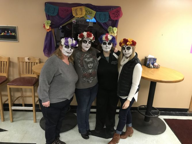 Romano's Saranac Lanes hosted a paint and sip Tuesday night where instead of the usual canvas, participants learned to paint their own faces as sugar skulls as part of Winter Carnival. (Photo provided)