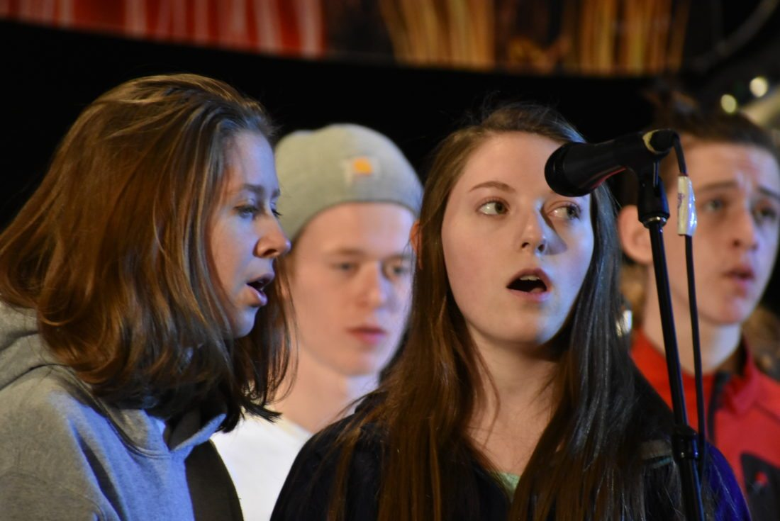 Kaylee McLean, left, and Jayda Buckley, right, practice their solos for the Rotary Club of Saranac Lake Variety Show. (Enterprise photo — Griffin Kelly)