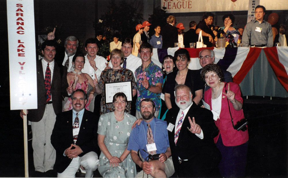Saranac Lake's All-America City delegation poses at a National Civic League meeting in summer 1998 in Mobile, Alabama. From left are, in the front row, Tom Catillaz, Cheri Fisher, Jim Sausville, Bob and Pat Brown, and in the back row, Corey Pandolph, Chuck Damp, Aggie Pelletieri, Eric Freeburg, Deborah McDonnell, Mike Burdeau, Zach Yousey, Sharon O'Brien, Terry Martino and Jacques DeMattos. (Photo provided)