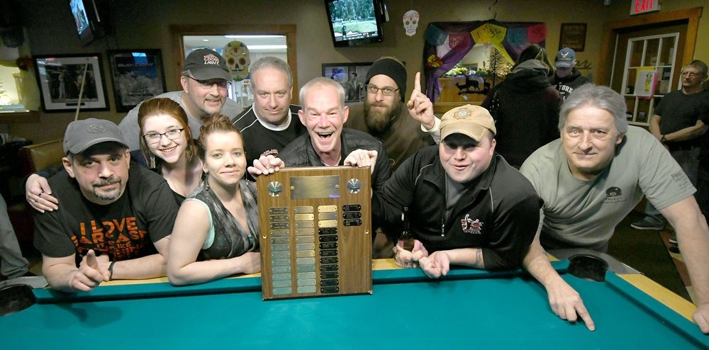 Members of the Moose Club celebrate their championship victory Thursday at Romano's Saranac Lanes. Team members from the left are: Alan Swentusky, Ashton Bushy, Brian Mott, Candace Brook Raymond, Tom Foley, Mike Hope, Rick Rosen, Steve Martin and Mark Stevens. Also on the team but not in the photo are Dave Wamsganz and Miranda Hope. (Enterprise photos — Lou Reuter)