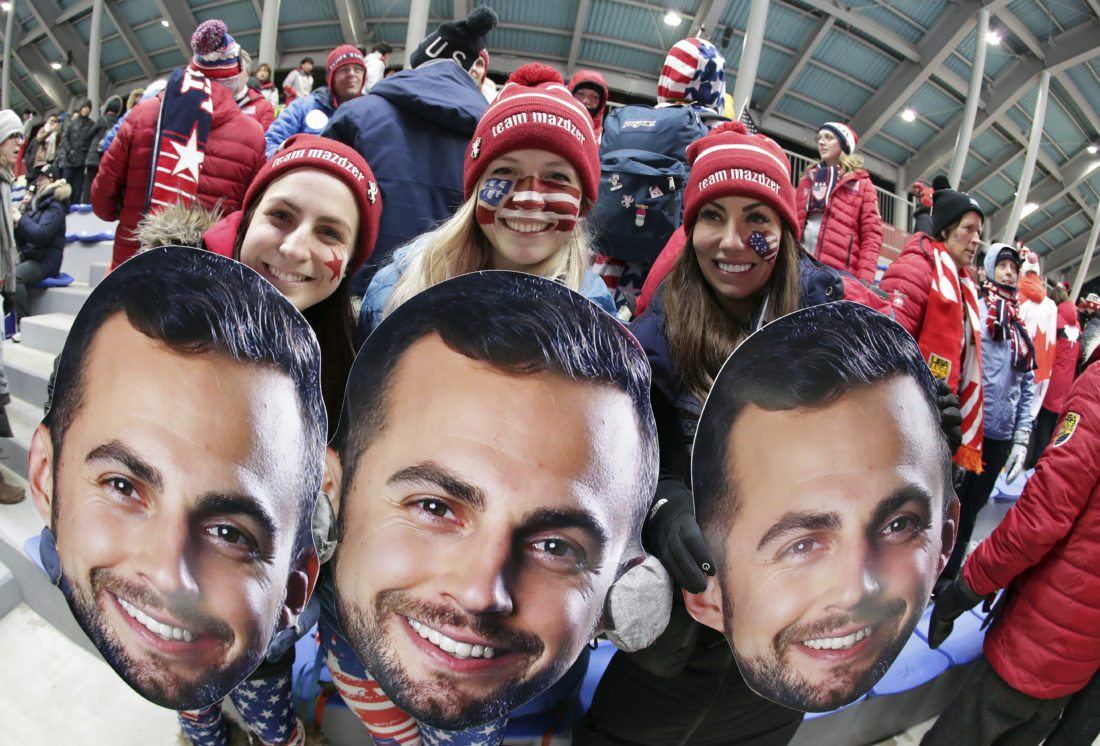 Supporters of luger Chris Mazdzer of the United States wait for the first run to start at the 2018 Winter Olympics in Pyeongchang South Korea Saturday Feb. 10 2018