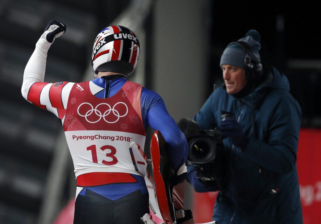 Chris Mazdzer of Saranac Lake celebrates his silver medal win Sunday at the 2018 Winter Olympics in Pyeongchang, South Korea. (AP Photo/Andy Wong)
