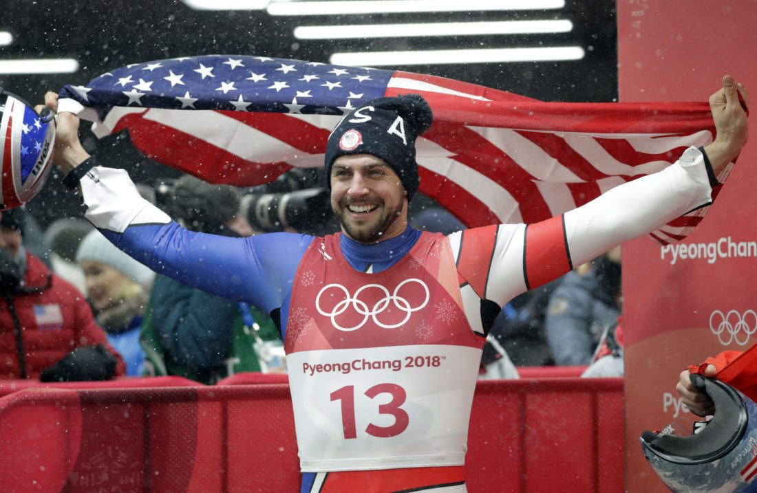 Chris Mazdzer of Saranac Lake celebrates his silver medal win during final heats of the men's luge competition at the 2018 Winter Olympics in Pyeongchang, South Korea, Sunday, Feb. 11, 2018. (AP Photo/Wong Maye-E)