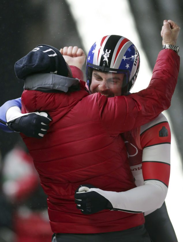 Chris Mazdzer celebrates his silver medal final run during final heats of the men's luge competition Sunday at the 2018 Winter Olympics in Pyeongchang, South Korea. (AP Photo/Michael Sohn)