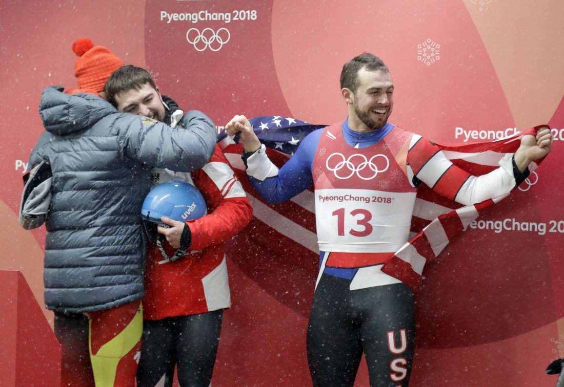 Chris Mazdzer, right, celebrates his silver medal win during final heats of the men's luge competition Sunday at the 2018 Winter Olympics in Pyeongchang, South Korea. (AP Photo/Wong Maye-E)