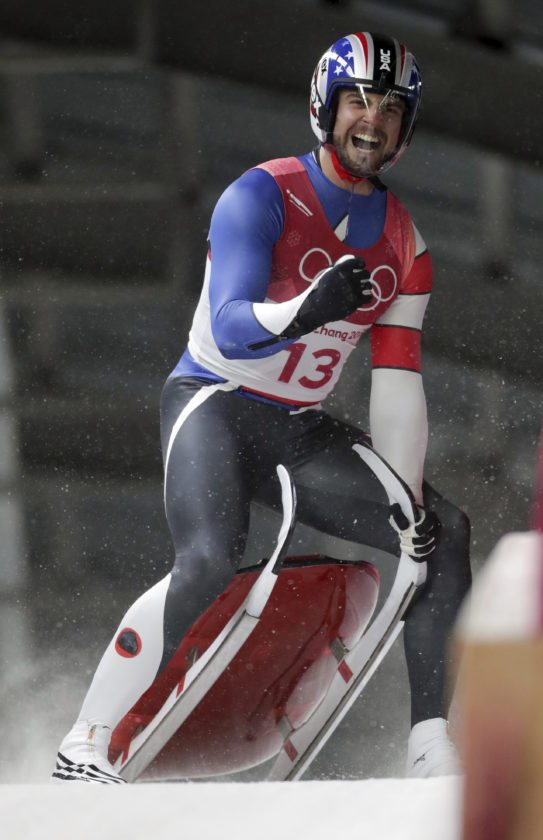 Chris Mazdzer of United States celebrates his silver medal final run during final heats of the men's luge competition at the 2018 Winter Olympics in Pyeongchang, South Korea, Sunday, Feb. 11, 2018. (AP Photo/Michael Sohn)
