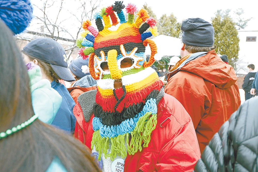"""Although this year's Winter Carnival theme was changed from """"Fiesta"""" to """"Festival"""" out of cultural sensitivity, many people still dressed up in Latin American garb, such as this colorful mask. (Enterprise photo — Lou Reuter)"""