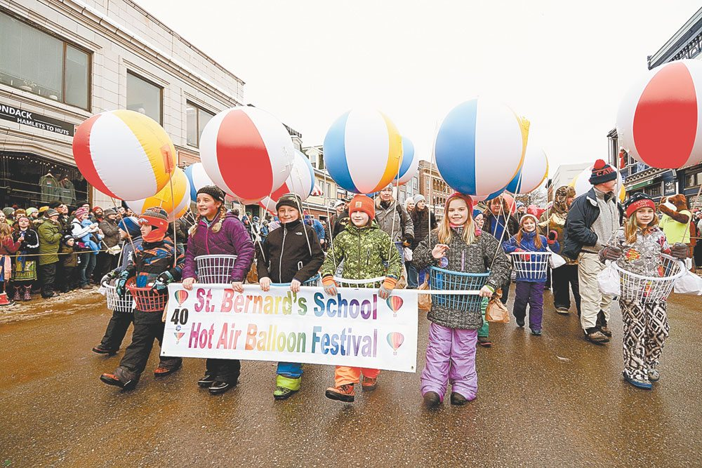 Students from St. Bernard's School dress up as hot-air balloons, with costumes made from beach balls and laundry baskets. Judges awarded them the first-place prize for the parade's best school walking group. (Enterprise photo — Lou Reuter)