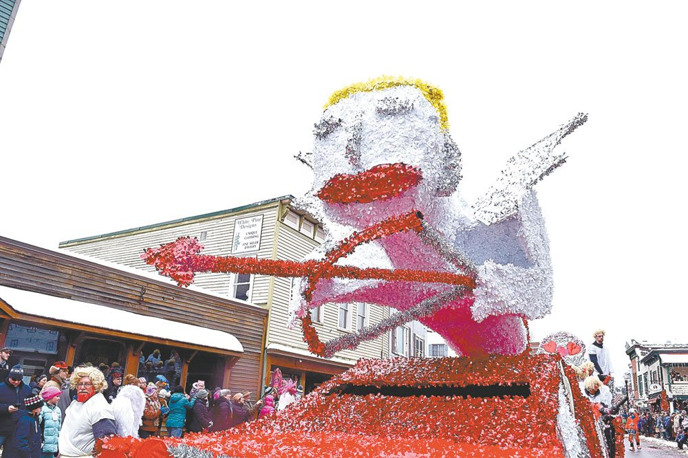 A giant Cupid soars atop the float put together by the Saranac Lake Kiwanis Club, with help from HomEnergy and Rumble Carpentry. (Enterprise photo — Glynis Hart)
