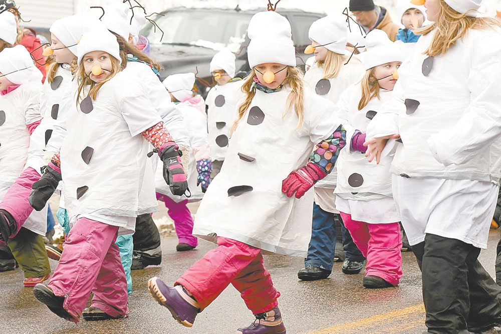 Dressed as snowpeople, students from Bloomingdale School do a dance step in the parade. Judges gave them second prize for best school walking group. (Enterprise photo — Lou Reuter)